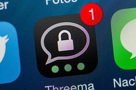 Die App Threema ist auf einem iPhone installiert und zeigt eine neue Nachricht an. Foto: Andrea Warnecke/dpa/Archivbild