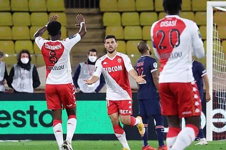 Kevin Volland (M.) war für Monaco der Matchwinner. Foto: Valery Hache/AFP/dpa