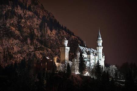 Das Schloss Neuschwanstein in den Abendstunden (2016). Foto: Karl-Josef Hildenbrand/dpa