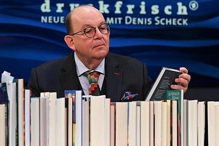 Denis Scheck hat sich mit Barack Obama unterhalten. Foto: Arne Dedert/dpa