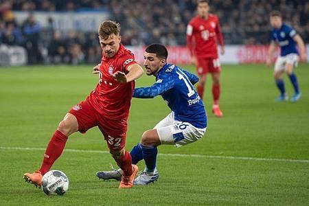 Joshua Kimmich (l) ist beim FCBayern München nicht mehr wegzudenken. Foto: Bernd Thissen/dpa
