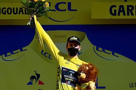 Verteidigte sein Gelbes Trikot erfolgreich: Adam Yates. Foto: Stuart Franklin/AFP/dpa