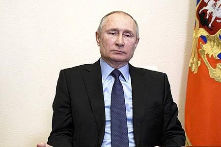 Der amerikanische Geheimdienst kommt zu dem Schluss, dass Präsident Wladimir Putin und seine Regierung den Ausgang der US-Wahl beeinflussen wollten. Foto: Alexei Druzhinin/Pool Sputnik Kremlin/AP/dpa