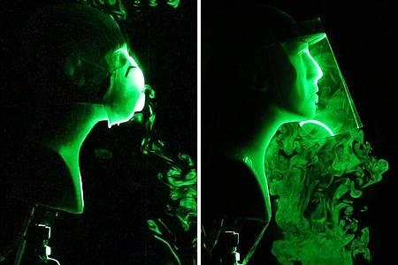 Die Bildkombo zeigt einen wissenschaftlichen Versuch, bei dem die Strömung künstlich hergestellter Atem-Tröpfchen beim Tragen einer N-95-Gesichtsmaske mit Ausatemventil (l) und einem Gesichtsschild (r) simuliert wird. Foto: -/Florida Atlantic University`s College of Engineering and Computer Science/dpa