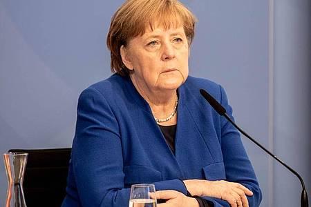Bundeskanzlerin Angela Merkel (CDU) nimmt am digitalen Petersberger Klimadialog teil. Foto: Filip Singer/EPA Pool/dpa