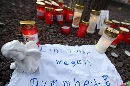 Dezember 2019: Kerzen am Königsplatz in Augsburg. Foto: Stefan Puchner/dpa