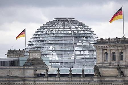 Das Reichstagsgebäude mit der transparenten Kuppel. Foto: Florian Schuh/dpa