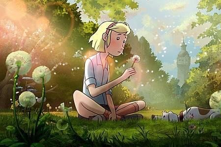 Fritzi und Sputnik auf einer Sommerwiese in einer Szene von «Fritzi - eine Wendewundergeschichte». Foto: --/MDR/Weltkino Filmverleih/dpa