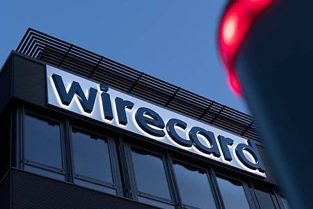 Schriftzug von Wirecard ist an der Firmenzentrale des Zahlungsdienstleisters in Aschbeim bei München zu sehen. Foto: Peter Kneffel/dpa