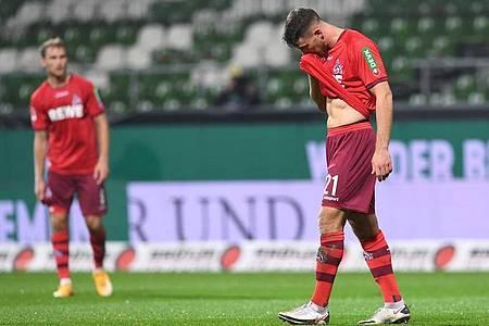 Trotz anfänglicher Führung in Bremen nicht gewonnen: Die Kölner lassen nach dem Spiel die Köpfe hängen. Foto: Carmen Jaspersen/dpa
