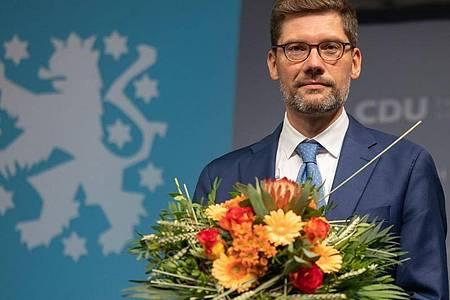 Der frühere Ost-Beauftragte der Bundesregierung, Christian Hirte, ist neuer Landesvorsitzender der Thüringer CDU. Der 44-Jährige wurde mit 67,6 Prozent der Stimmen gewählt. Foto: Michael Reichel/dpa