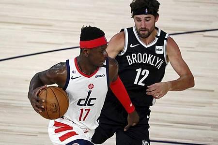 Isaac Bonga (l) verlor erneut mit den Washington Wizards. Foto: Kim Klement/Pool USA Today Sports/AP/dpa