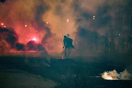 In Paris kam es zu Ausschreitungen. Foto: Alain Jocard/AFP/dpa