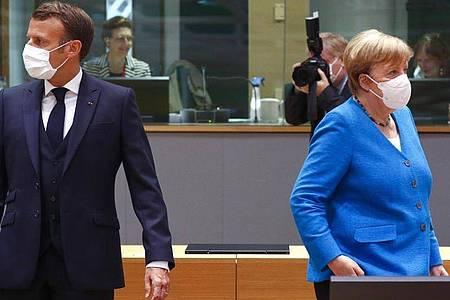 Bundeskanzlerin Merkel und der französische Präsident Macron zusammen beim EU-Gipfel. Foto: Francois Lenoir/Reuters Pool/AP/dpa