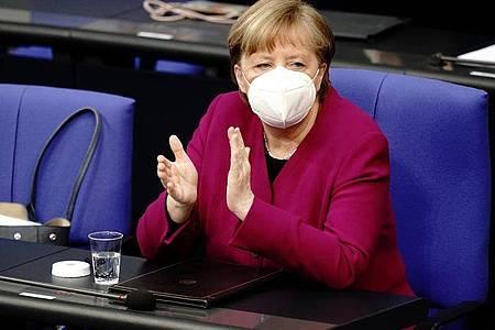 Kanzlerin Angela Merkel möchte im Bundestag die Corona-Notbremse beschließen. Foto: Kay Nietfeld/dpa